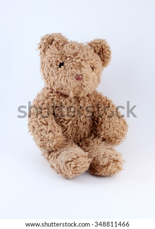 Old teddy bear toy on white background