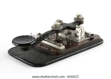 Old telegraph key over white background - stock photo