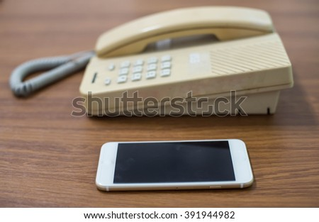 Old telephone and mobile,concepts compare new and old technologies . - stock photo