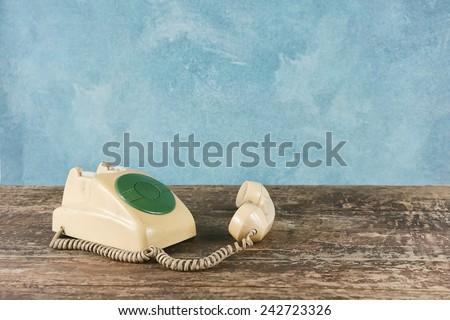old telephone on vintage background - stock photo