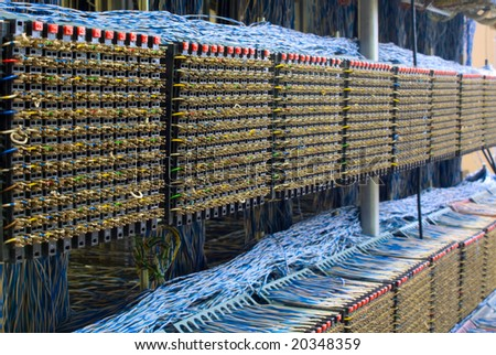 old telephone switchboard with wires of white and dark blue colors - stock photo