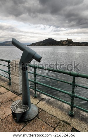 old  telescope, view of Maggiore Lake and Rocca di Angera, Italy