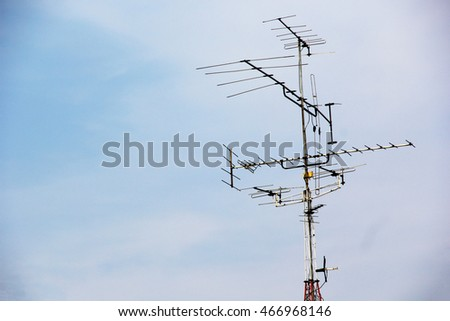OLd Television antenna with blue sky background