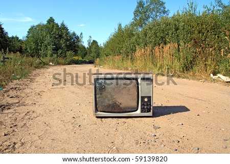 old television set on road - stock photo