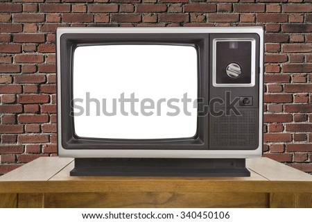 Old television with cut out screen and brick wall. - stock photo