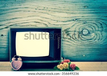 old television with wooden wall background