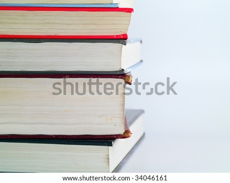 Old Textbooks stacked on a blank background - stock photo