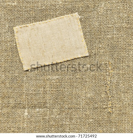 Old textile tag on the sacking - stock photo