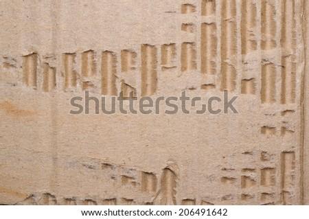 old textured cardboard background torn. Macro - stock photo