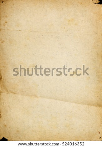 Old textured paper page with stains, folds and raggy corners
