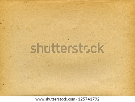 Old textured recycled paper with natural fiber parts - stock photo