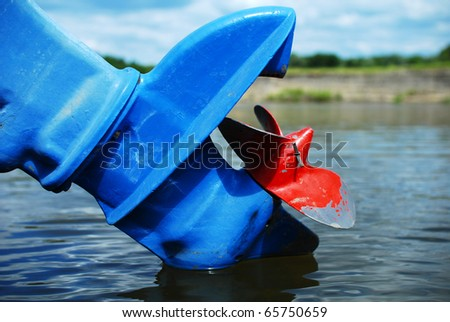Old three-bladed motorboat propeller - stock photo