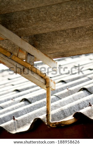 Old tile roof texture & drain water pile - stock photo