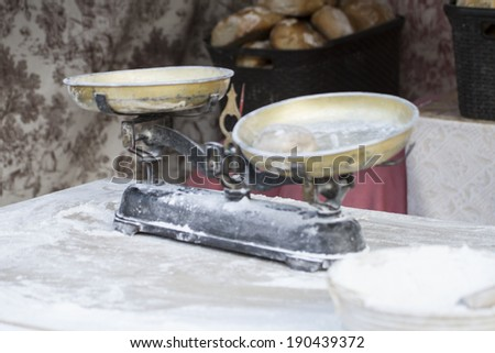 old tilted to weigh flour, medieval fair - stock photo