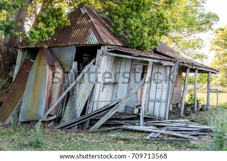Old Timber House Abandoned And Falling Apart