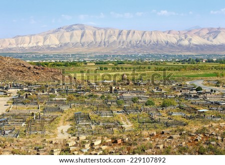 Old-time armenian cemetery on background of the mountain landscape - stock photo