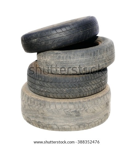 Old tires stacked, isolated on white background - stock photo