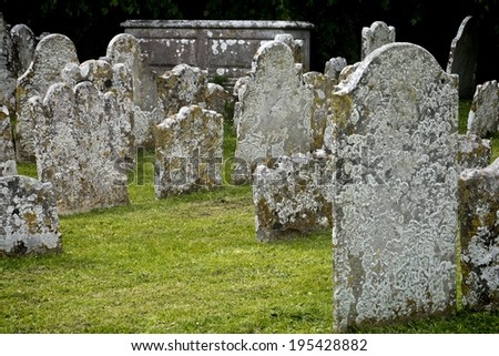Old tomb stones; jumble of lichen-covered tombstones in cemetery