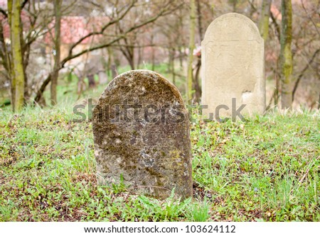 Old tombstone in jewish cemetery - stock photo