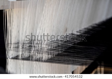 old tool to make the thread bobbin for the shuttle of ancient loom and Cotton is raw for weave, tools to work natural textile fiber - stock photo