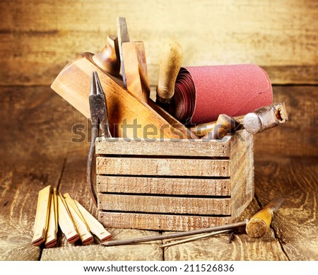old tools in a box on wooden background