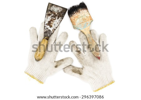Old tools include Gloves, paint brushes and trowel - stock photo
