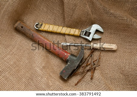 Old tools on a background of burlap.