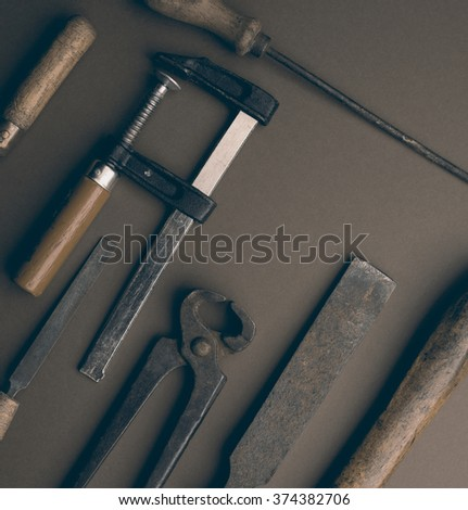 old tools on the brown background - stock photo