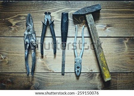 old tools on wooden background - stock photo