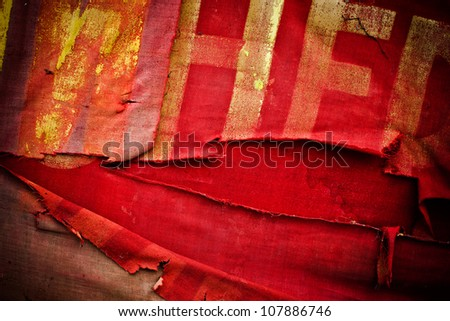 Old torn communistic flag - stock photo