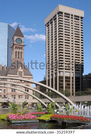 Old Toronto City Hall and new highrise building - stock photo