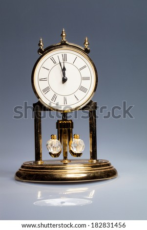 Old tower clock with rotating pendulum - stock photo