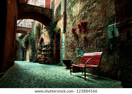 Old town alley in Tuscany Italy - stock photo