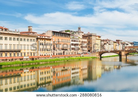 old town and river Arno reflecting in water at summer day, Florence, Italy - stock photo