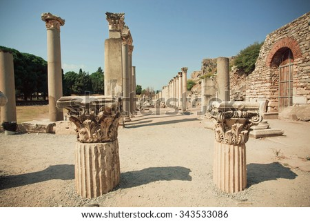 Old town area with broken columns and ruined defensive walls of Greek-Roman city Ephesus. Ancient city Ephesus founded on 10th century BC, now it is Turkey.   - stock photo