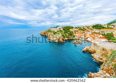 Old town Dubrovnik, buildings with orange roofs, Adriatic sea in Croatia - stock photo