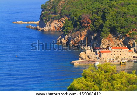 Old town harbor on the shores of Adriatic sea - stock photo