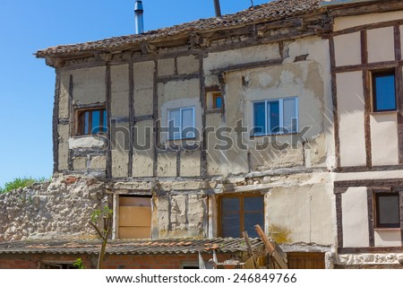 old town house with broken walls and modern windows - stock photo