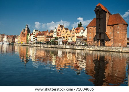 Old Town of Gdansk (Danzig) in Poland with Motlava river and the Crane on the far end - stock photo