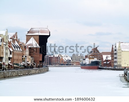 Old Town of Gdansk (Danzig) in Poland with Motlava river and the Crane (Polish: Zuraw). Winter scenery - stock photo