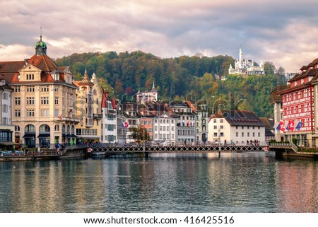 Old town of Lucerne and Chateau Gutsch on Reuss River, Switzerland - stock photo