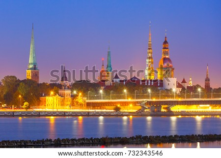 Old Town of Riga and River Daugava at night, Riga Cathedral, Saint Peter church, Cathedral Basilica of Saint James and Riga castle in the background, Latvia