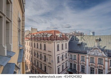 Old Town of Riga (Vecriga), Latvia-September 27, 2015: Early morning views of old houses roofs, windows, skylights, dormers, cornices, chimneys, chimney stacks chimney pots, towers, antennas