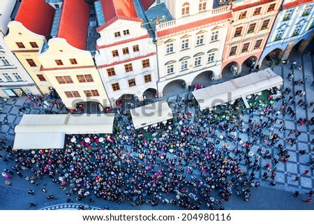 Old Town square with tourist crowd in Prague, Czech Republic, view from above Staromestska radnice - stock photo