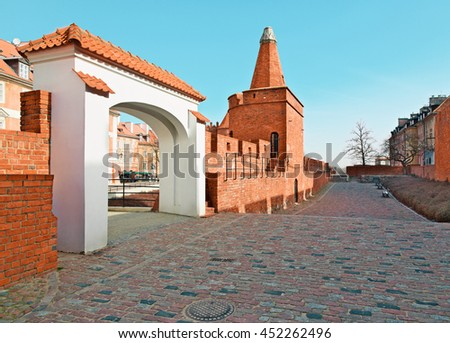 Old town wall and arc near Barbican, Warsaw city, Poland - stock photo
