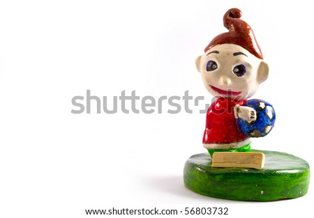 Old toy toy goalkeeper - stock photo