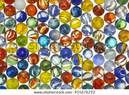 Old toy translucent marbles macro. - stock photo