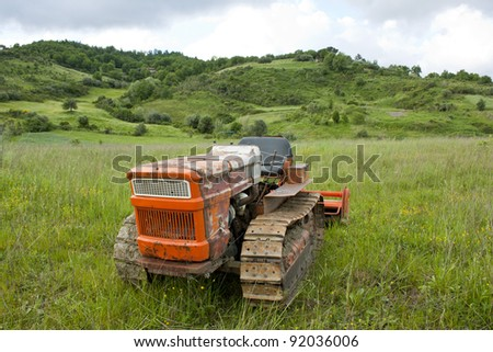 old tractor abandoned in a field
