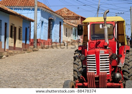 Old tractor in rural Cuban street - stock photo