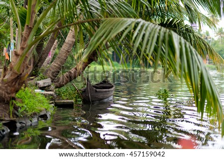 Old traditional boat on a river, backwaters Kerala, India